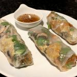 side angle photo of three rolls of banh xeo