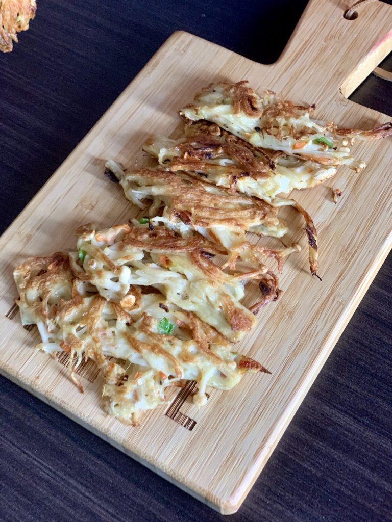 crispy mushroom pancakes on a platter