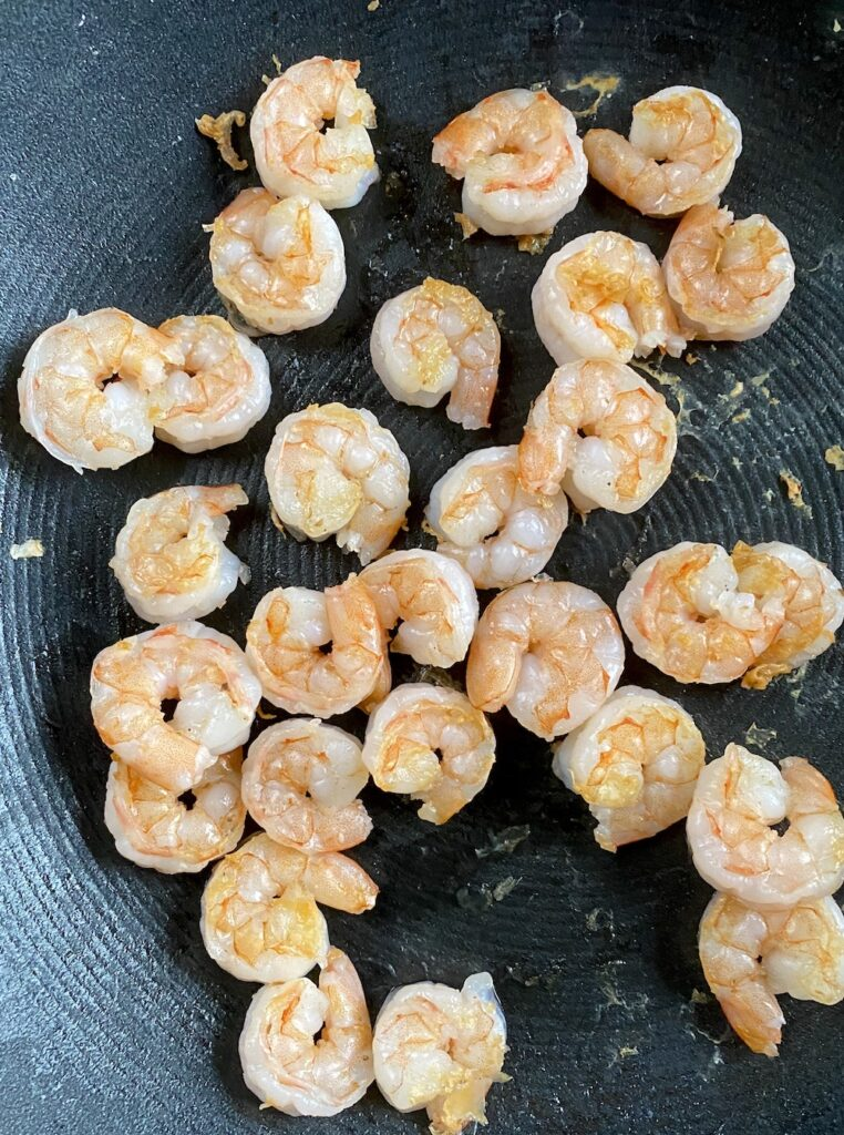 shrimp frying in a pan