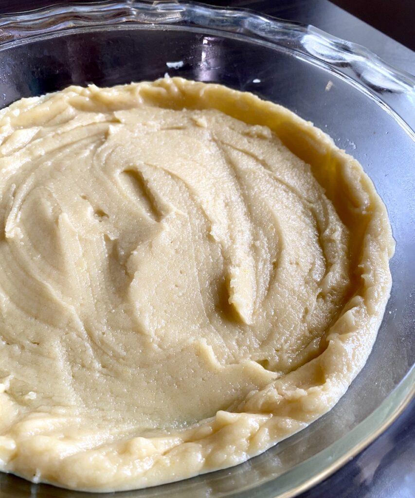 spreading pie crust into pie pan