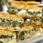 Spanakopita appetizers stacked on top of each other