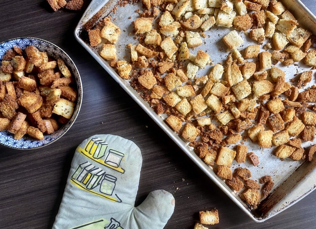 croutons on a baking tray and in bowl