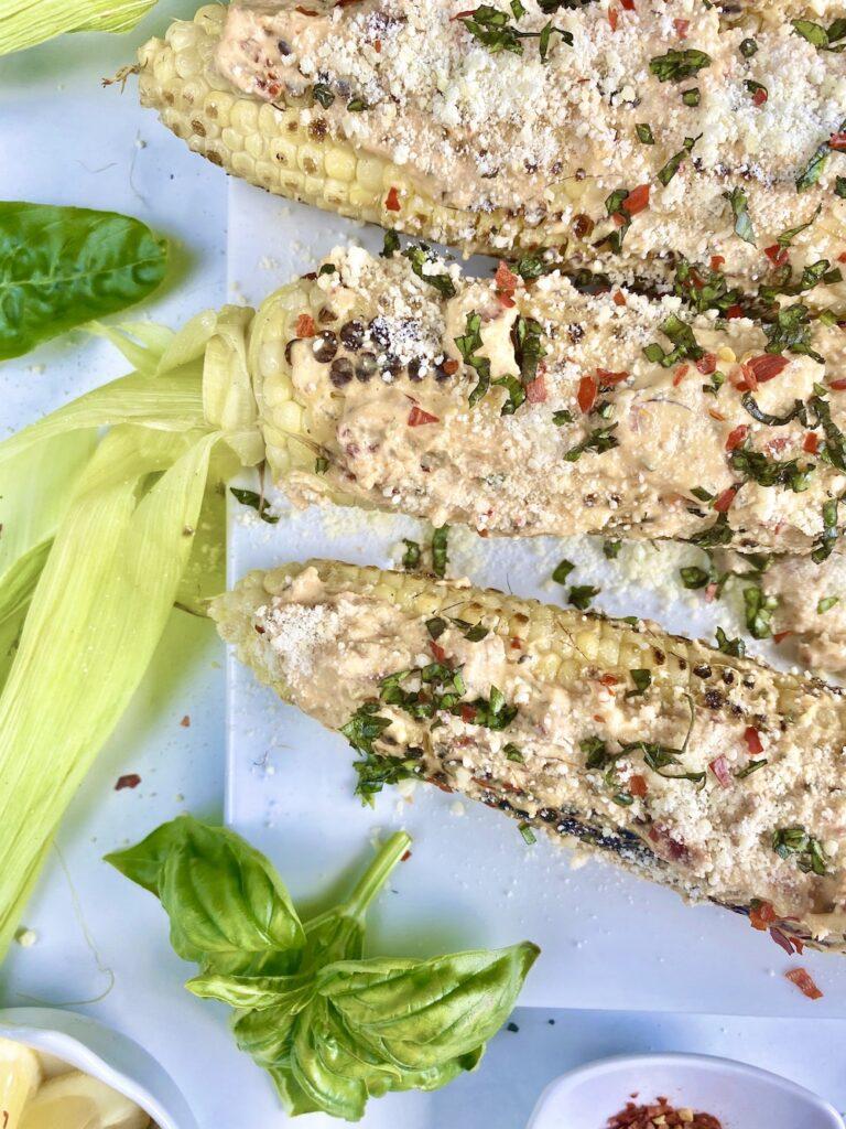close up image of Italian street corn on a plate