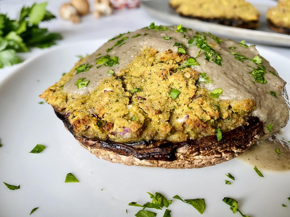 vegan stuffed mushrooms with herb gravy on a plate