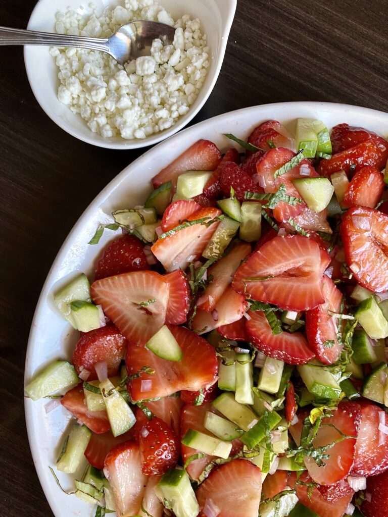 strawberry fruit salad with goat cheese on the side