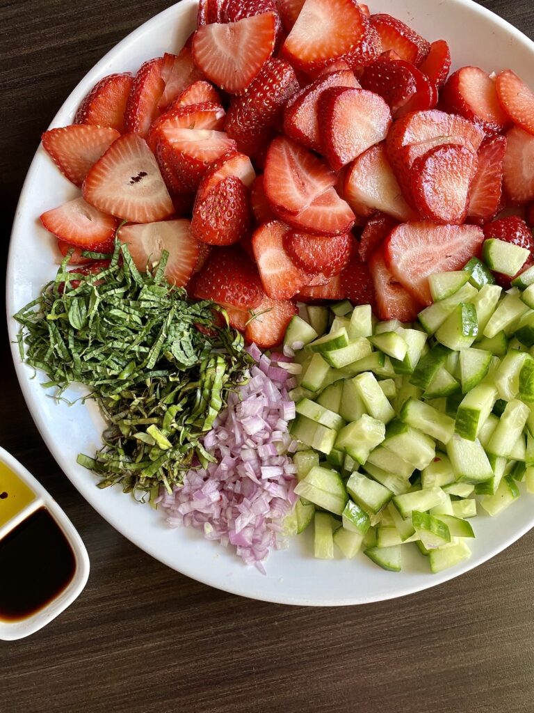 chopped fruits and herbs for strawberry fruit salad